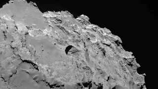 This photo made by the European Space Agency's Rosetta spacecraft and provided by researchers led by Jean-Baptiste Vincent shows the most active pit, known as Seth_01, which scientists believe is one of several sinkholes on the comet 67P/Churyumov-Gerasimenko.