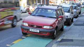 Cape Town 150703. Motorist  parked their cars in a  lane meant to be used by Cyclists in Albert raod, Woodstock. Picture Cindy waxa.Reporter Kieran/Argus