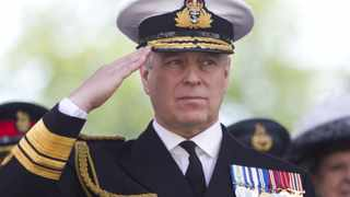 Britain's Prince Andrew, Duke of York salutes military personnel during the Armed Forces day parade in Guildford on June 27, 2015. Picture: Justin Tallis