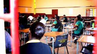 Kliptown Secondary School class of 2014 gather in a nearby church hall to write their final exams. The school is expected to achieve above 95 %.  Picture: Timothy Bernard 28.10.2014