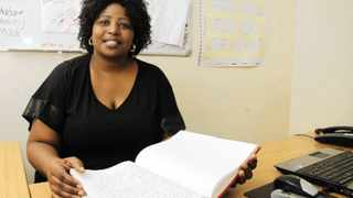 Studying is all in a days work for Zinhle Nkosi, the first UKZN student to graduate with a PhD in teaching reading in Zulu at the foundation phase. Photo: Ryan Shepherd