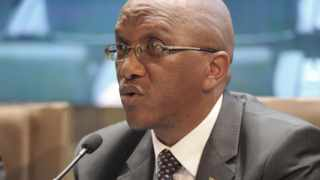 South Africa's Auditor-General (AG) Kimi Makwetu releasing the audit results of the country's municipalities for the financial year 2012-13 joined by Minister Pravin Godhan (Cooperative Governance And Traditional Affairs) and Collins Chabane (Public Service and Administration)/ 30-07/2014