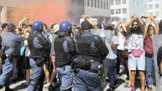 Students and police clash in the parliamentary precinct. Picture: Mlondolozi Mbolo