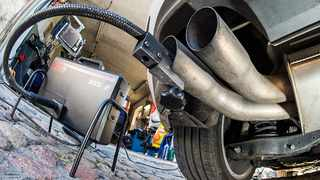 A measuring hose for emissions inspections in diesel engines sticks in the exhaust tube of a Volkswagen (VW) Golf 2,0 TDI diesel car at a garage in Frankfurt an der Oder, eastern Germany, on October 1, 2015. Volkswagen has admitted that up to 11 million diesel cars worldwide are fitted with devices that can switch on pollution controls when they detect the car is undergoing testing.       AFP PHOTO / DPA / PATRICK PLEUL   +++   GERMANY OUT   +++