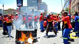 Protesting Pikitup workers burned rubbish bins outside the Pikitup headquarters in Braamfontein, it's still unclear what are workers grievances are. Picture: Itumeleng English 24.11.2015 594
