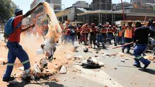 A worker trashes the street during the Samwu march in Joburgs CBD. Picture: Boxer Ngwenya