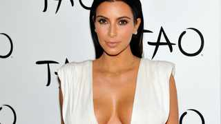Kim Kardashian at the Tao Nightclub at The Venetian Las Vegas to celebrate her 34th birthday on October 25, 2014 in Las Vegas, Nevada. The concept of needing a petrol-guzzling wholly-owned state airline in 2019 is as outdated as the concept Kim Kardashian wearing a bra to the Oscars, says the writer. Photo: David Becker/Getty Images/AFP