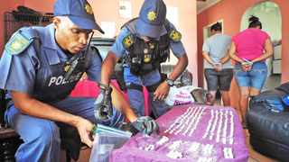 SCOURGE: Officers count drugs seized during a raid at a Cape Town house. The Russia-Africa anti-drug dialogue discussed the scourge of drug proliferation. It has emerged that traffickers are moving highly addictive drugs through the country. The conference was held as South Africa prepares to launch specialised units to deal with drug smuggling.Photo: David Ritchie