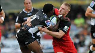 Lwazi Mvovo of the Sharks is tackled by Johnny McNicholl of the Crusaders during their nail-biting Super Rugby stand-off in Durban. Photo: MUZI NTOMBELA