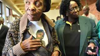 Dorah Simelane with a family friend, Thandi Masilela, is seen wearing a t-shirt showing her granddaughter, Nokuthula Simelane's face at the Pretoria Magistrate Court. Simelane's family believes she was murdered by former security police officers and will this Thursday ask the Gauteng High Court, Pretoria, to declare her to be presumed dead. File picture: Phill Magakoe.