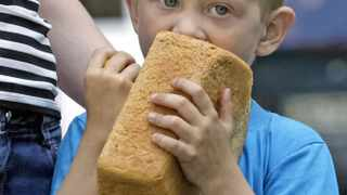 epa04781321 A young boy eats a loaf of bread which he got from volunteers of the self-proclaimed Donetsk People's Republic (DNR) as they distribute bread for local citizens in Donetsk, Ukraine, 03 June 2015. An estimated two million people have fled the fighting between pro-Russian separatists and Ukrainian government forces. Some 1.2 million have remained in Ukraine, while about 800,000 have left the country, the German news agency dpa reported. The Ukrainian government and pro-Russian separatists have largely failed to honour the human rights commitments they made as part of their February ceasefire deal, the UN human rights office in Geneva, Switzerland, had criticized on 01 June.  EPA/ALEXANDER ERMOCHENKO