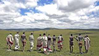 "Initiates pose as they walk on a field in Qunu, in the Eastern Cape December 15, 2013. Every year, thousands of youths leave their parents to spend weeks in the care of traditional leaders at an initiation school where they are circumcised, a rite of passage commonly referred to as ""Ukwaluka"" or ""going to the mountain"". Former South African President Mandela, who died on December 5 aged 95, will be buried in his family homestead in Qunu on Sunday after a state funeral. REUTERS/Siegfried Modola (SOUTH AFRICA - Tags: SOCIETY)"