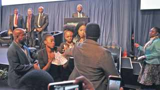 A group of 4 protesting ladies staged a silent protest with messages during jacob Zuma's speech, they were then approached by security personel after Jacob Zuma left the podium. National IEC results centre in Pretoria for the official results to be announced on Saturday 6th August. Picture: Antoine de Ras, 06/08/2016