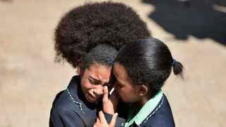 Pupils from Pretoria High School for Girls comfort each other following a meeting with Gauteng MEC for Education,Panyaza Lesufi.  Picture: Phill Magakoe