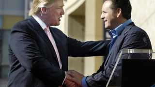 """Donald Trump (L) is congratulated by Mark Burnett, creator and executive producer of Trump's reality television series """"The Apprentice,"""" before receiving a star on the Hollywood Walk of Fame in Los Angeles, California January 16, 2007. REUTERS/Chris Pizzello (UNITED STATES) - RTR1L9R0"""