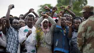 This file photo taken on October 2, 2016 shows residents of Bishoftu crossing their wrists above their heads as a symbol for the Oromo anti-government movement during the Oromo new year holiday. Picture: Zacharias Abubeker