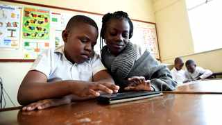 In this file picture, Brighton Ndlovu and Mbali Sibanda do an assignment with their new gadget during a handover of PPC's IPAD learning programme at Forest Town School for Learners with Special Needs by Deputy Social Development  Minister Hendrietta Bogopane-Zulu.Picture: Nokuthula Mbatha