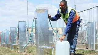 Brandon Herringer testing one of the taps that will assist Maitland residents when Day Zero arrives and the taps are turned off. Picture: Cindy Waxa/African News Agency/ANA
