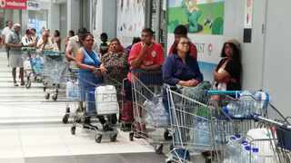 People queue for water at a supermarket in Ottery. Picture: City of Cape Town