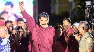 Venezuelan President Nicolas Maduro stands before a crowd at Miraflores Palace after he claimed victory. Picture: Luxembourg Times