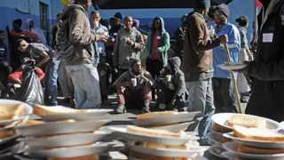 HELPING OUT: The Souper Troopers provided food, cake and drinks to hundreds of homeless people at the Carpenters Shop in Roeland Street to celebrate Mandela Day. Picture: Armand Hough/African News Agency (ANA)