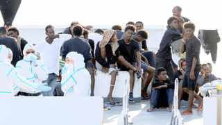 Migrants wait to disembark from the Italian coast guard vessel Diciotti at the port of Catania, Italy, on Wednesday. Picture : Antonio Parrinello/Reuters