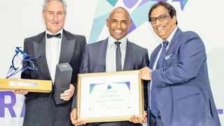 THE CHIEF executive of Kagiso Asset Management, Roland Greaver (centre), receives the Chairman's Raging Bull Award for the Black Manager of the Year from Martin Hesse, the content editor of Personal Finance, and Dr Iqbal Survé, the chairman of Independent Media.