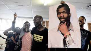 A file picture of friends of Sibusiso Khwinana holding a poster of him at a memorial service for the actor. Jacques Naude/African News Agency (ANA)