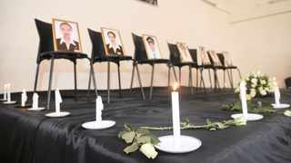 FRAMED photographs of the seven crew members displayed at a memorial service held by an association of Ethiopian airline pilots, in Addis Ababa, Ethiopia yesterday.     AP