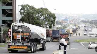Trucks were left abandoned in the Bayhead area in Durban yesterday amid protest action.     Sibonelo Ngcobo African News Agency (ANA)