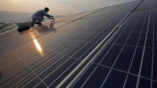 A worker performs maintenance work on solar panels at a photovoltaic power station in Songxi county in China's Fujian province. From a virtual non-contender in the field of renewable energy production just over 10 years ago, the country has now become a world leader in renewables.     AP African News Agency (ANA)