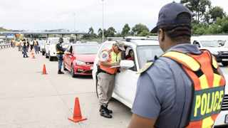 A traffic officer stops a vehicle during a roadblock. File Picture: Doctor Ngcobo / ANA