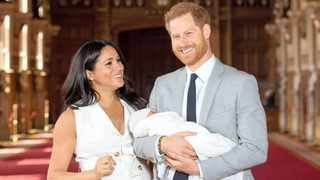 Britain's Prince Harry and Meghan, Duchess of Sussex hold their baby son, who was born last week, during a photo call in St George's Hall at Windsor Castle.     Reuters