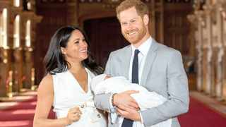 Britain's Prince Harry and Meghan, Duchess of Sussex hold their baby son, who was born last week, during a photo call in St George's Hall at Windsor Castle. Picture:  Reuters
