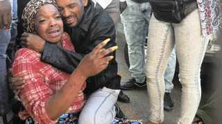 Antonette Mabiala, the mother of Grade 8 pupil Daniel Bakwela, who was slain outside Forest High School in Turffontein yesterday, is comforted by relatives and friends after the alleged gang stabbing. Photo: Itumeleng English African News Agency (ANA).