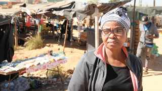 MARY CHOMA in front of some of the traders' stalls at Denneboom railway station.     African News Agency (ANA)