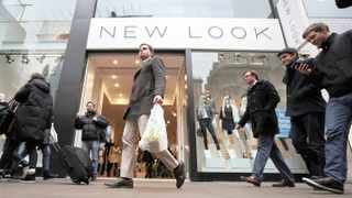 British fashion chain New Look reported a bigger annual pretax loss, hurt by a large charge, while Brexit woes and rainy weather kept many shoppers out of its stores.   Bloomberg