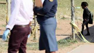 POLICE officers at the scene of a shooting at a school in Folweni last month.     Motshwari Mofokeng  African News Agency (ANA)