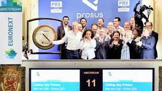 NASPERS and Prosus chief executive Bob van Dijk rings a gong to mark Prosus's debut on the Amsterdam Stock Exchange. Reuters