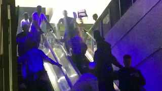 Videos made of the brawl on an escalator inside the mall have gone viral on social media. Screengrab.