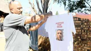 DEAN JAPHTA'S father, Denzyl Jafta, holds a T-shirt with the face of his late son at his home in Eersterust.   Picture:  African News Agency (ANA)
