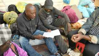 Refugees housed in and around the Central Methodist church at Greenmarket Square were served a notice to appear in court on December 9. Picture: Courtney Africa / African News Agency (ANA)