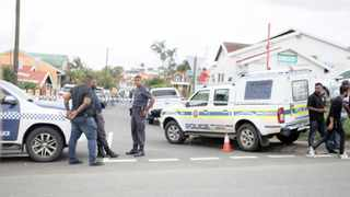 Metro police and SAPS blocked off Alfawood Road after Warrant Officer T Pillay and an unknown man were shot dead in Phoenix.     Bongani Mbatha African News Agency (ANA)