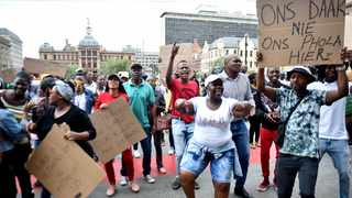 Backyard dwellers from Mamelodi demonstrate outside the Gauteng High Court, Pretoria, where an application for their eviction was being heard.     Thobile Mathonsi African News Agency (ANA)