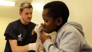 Nursing assistant Jaque le Roux with puppy Faith and Pallo Gigi.     Tracy Adams  African News Agency (ANA)