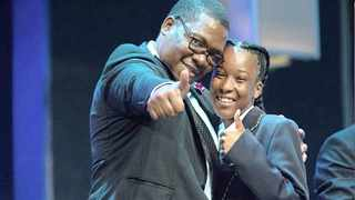DIMAKATSO LETHABO MAKWINGE, who matriculated from Fred Norman Secondary School last year, is congratulated by MEC Panyaza Lesufi during Grace Bible Church's Achievers Awards yesterday. The recipients were given a trophy and an education grant of R25000. Picture: Supplied