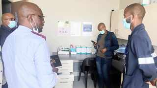 THE MANAGER at Block JJ Clinic in Soshanguve, Nape Mpaketsane, explains the Covid-19 screening and testing measures to officials from the Department of Infrastructure Development.