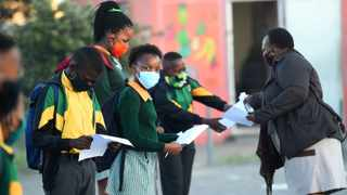 Grade 7 pupils at Nomsa Mapongwana Primary School in Khayelitsha are screened as they arrive at school. Picture: Phando Jikelo / African News Agency (ANA)