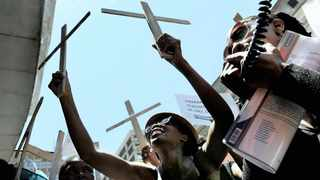 Families of the Life Esidimeni deceased psychiatric patients carry wooden crosses outside the Health Department in Johannesburg. Picture: Chris Collingridge