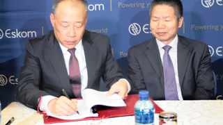 Li Gang, deputy director-general of China Development Bank (CDB), and Yansong Rong of the Embassy of the People's Republic of China in South Africa, at the signing ceremony of the $1.5 billion loan agreement between Eskom and the CDB. Photo: Dimpho Maja